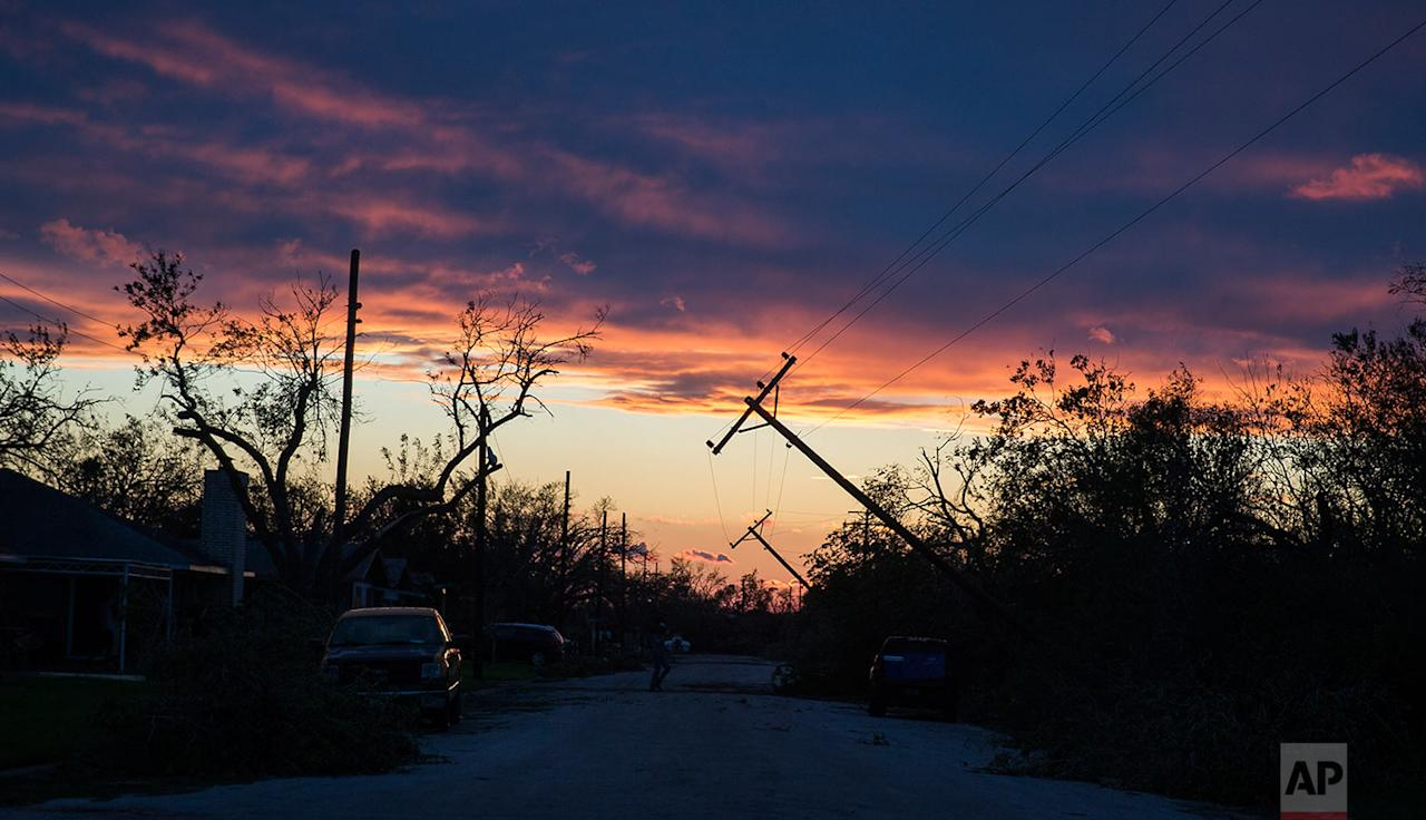 <p></p><p>Power poles blown by Hurricane Harvey lean over a road in Refugio, Texas. (Nick Wagner/Austin American-Statesman via AP) </p><p></p>