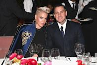 """<p>Pop star Pink started dating Carey Hart in 2001 after meeting at the Summer X Games, according to <a href=""""https://www.usmagazine.com/celebrity-news/pictures/pink-and-carey-harts-relationship-timeline/"""" rel=""""nofollow noopener"""" target=""""_blank"""" data-ylk=""""slk:Us Weekly"""" class=""""link rapid-noclick-resp"""">Us Weekly</a>. After a brief split in 2003, the duo got engaged in 2005 and walked down the aisle in 2006. The couple was married for two years when they split. They had divorce papers ready, but reconciled before it was finalized. Pink and Carey went to couples' counseling and welcomed their first child in 2011 and their second in 2016. Since then, they have been a tight-knit family.</p>"""