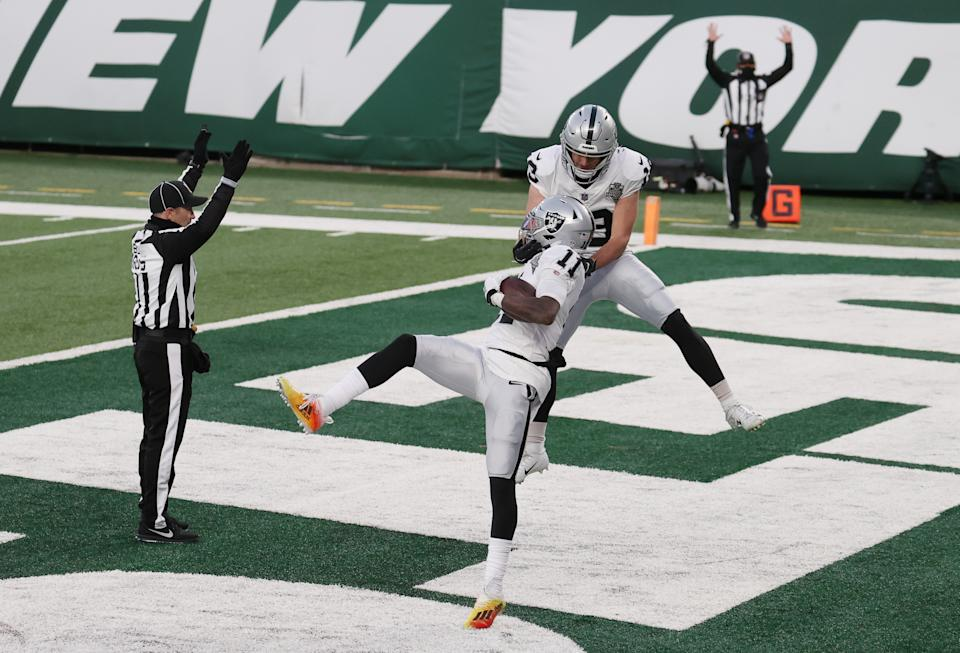 EAST RUTHERFORD, NEW JERSEY - DECEMBER 06: Hunter Renfrow #13 of the Las Vegas Raiders celebrates with Henry Ruggs III #11 after his touchdown to win the game during the second half against the New York Jets at MetLife Stadium on December 06, 2020 in East Rutherford, New Jersey. The Las Vegas Raiders won 31-28. (Photo by Al Bello/Getty Images)