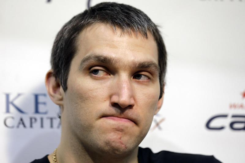 Washington Capitals captain and left wing, Alex Ovechkin, from Russia, pauses while speaking during a media availability at their NHL hockey practice facility, Tuesday, May 14, 2013 in Arlington, Va. The Capitals were eliminated in the first round of the playoffs by the New York Rangers.(AP Photo/Alex Brandon)