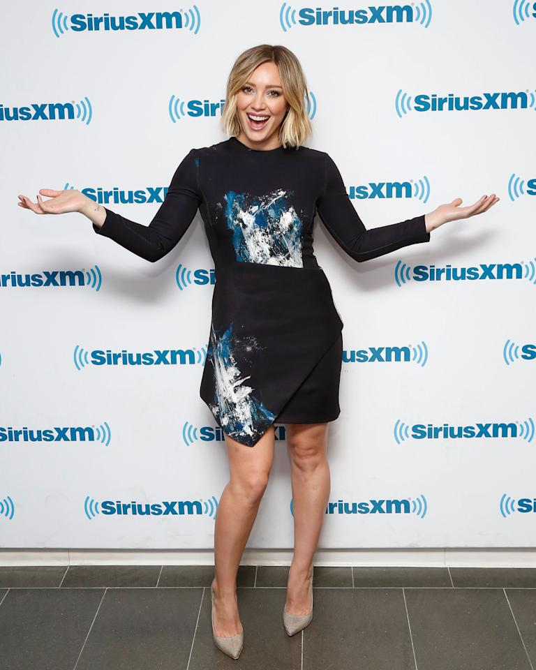<p>Hil-D went the artsy route to promote her show <i>Younger</i> at SiriusXM studios. She rocked a black, long-sleeve top and asymmetric skirt with an abstract, paint-spatter print. Taupey gray pumps rounded out Duff's look. <i>Photo: Getty</i></p>