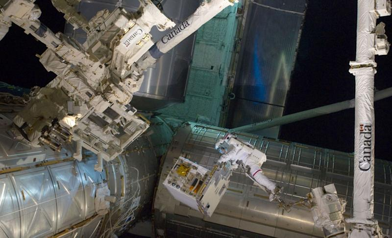 NASA image captured July 12, 2011 - With his feet secured on a restraint on the space station remote manipulator system's robotic arm or Canadarm2, NASA astronaut Mike Fossum (frame center) holds the Robotics Refueling Mission payload, which was the focus of one of the primary chores accomplished on a six and a half hour spacewalk on July 12. The failed pump module is with DEXTRE on left side of the photo. NASA astronauts Fossum and Ron Garan performed the six-hour, 31-minute spacewalk, which represents the final scheduled extravehicular activity during shuttle missions. Among Atlantis's final contributions to the ISS is the Robotic Refueling Mission, developed at Goddard Space Flight Center. Atlantis brought this module to the International Space Station, where it will provide key support in maintaining future spacecrafts for years to come. STS-135 astronauts traveled to Goddard to complete special training for these robotics, a major component of the final shuttle mission. RRM is one of dozens of Goddard payloads to travel aboard orbiters into space throughout the 30-year flight history of the Shuttle Program. NASA Goddard Space Flight Center enables NASA's mission through four scientific endeavors: Earth Science, Heliophysics, Solar System Exploration, and Astrophysics. Goddard plays a leading role in NASA's accomplishments by contributing compelling scientific knowledge to advance the Agency's mission.