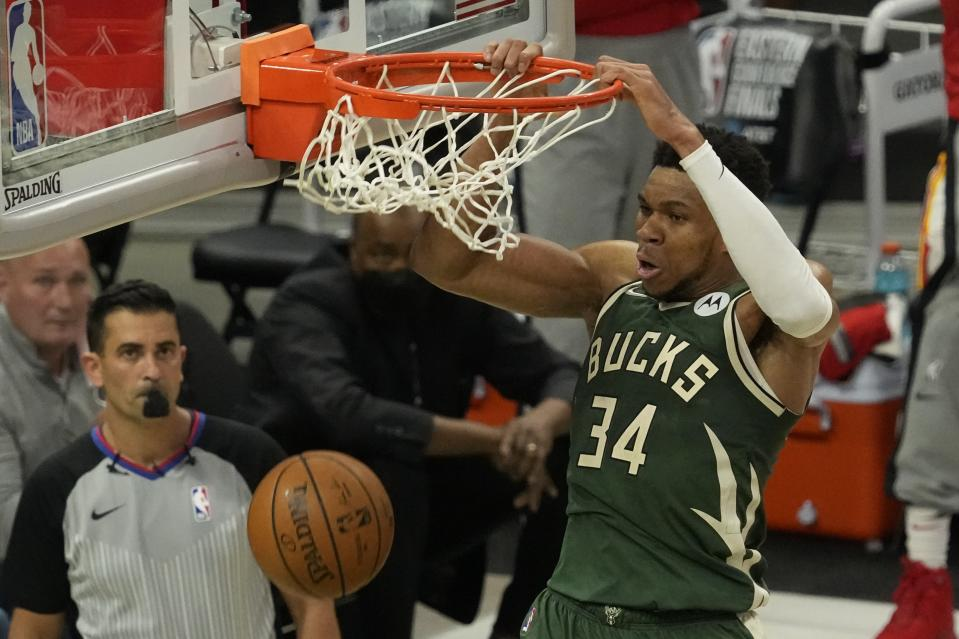 Milwaukee Bucks' Giannis Antetokounmpo dunks during the second half of Game 1 of the NBA Eastern Conference basketball finals game against the Atlanta Hawks Wednesday, June 23, 2021, in Milwaukee. (AP Photo/Morry Gash)