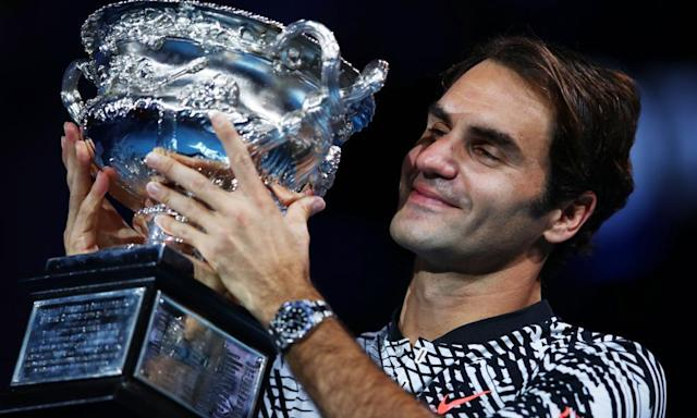 "<span class=""element-image__caption"">Roger Federer with the trophy after defeating his nemesis Rafael Nadal to win the Australian Open, his 18th grand slam title, in January.</span> <span class=""element-image__credit"">Photograph: Clive Brunskill/Getty Images</span>"