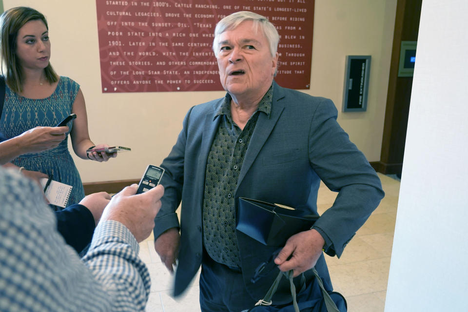Penn State President Eric Barron pauses to speaks to reporters after the College Football Playoff presidents group meeting Tuesday, June 22, 2021, in Grapevine, Texas. The CFP presidents group met to discuss a proposed plan to expand the postseason format from four to 12 teams. (AP Photo/LM Otero)