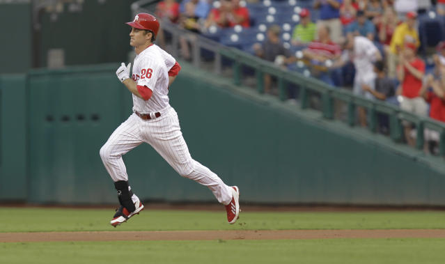 Philadelphia Phillies' Chase Utley runs the bases after hitting a home run in the first inning in a baseball game against the Colorado Rockies, Wednesday, Aug. 21, 2013, in Philadelphia. (AP Photo/Laurence Kesterson)