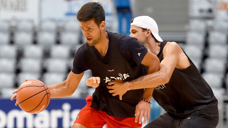 Pictured here, tennis rivals Novak Djokovic and Grigor Dimitrov playing basketball together.