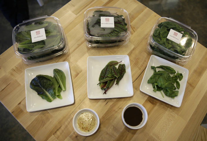 In this Thursday, Sept. 27, 2018, photo from left, packages of red romaine, red veined sorrel and basil are displayed at Iron Ox, a robotic indoor farm, in San Carlos, Calif. At the indoor farm, robot farmers that roll maneuver through a suburban warehouse tending to rows of leafy, colorful vegetables that will soon be filling salad bowls in restaurants and eventually may be in supermarket produce aisles, too. (AP Photo/Eric Risberg)