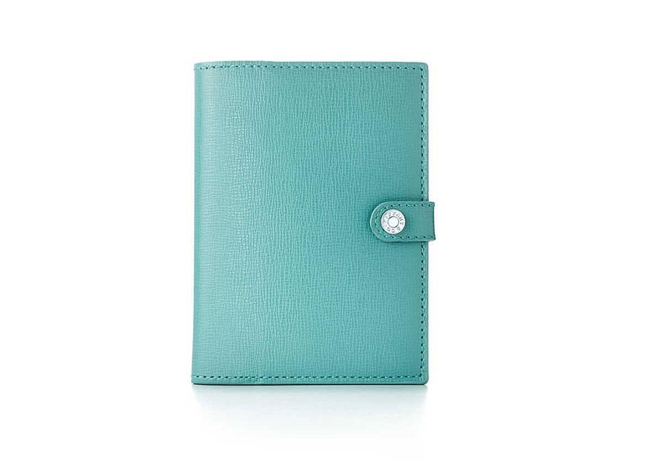 "<p>Tiffany & Co. Passport Cover, $150, <a href=""http://www.tiffany.com/Shopping/Item.aspx?fromGrid=1&sku=GRP08373&mcat=&cid=&search_params=p+1-n+10000-c+-s+1-r+-t+passport-ni+1-x+-lr+-hr+-ri+-mi+-pp+0+1&search=1&origin=search&searchkeyword=passport&selectedsku=33780575"" rel=""nofollow noopener"" target=""_blank"" data-ylk=""slk:tiffany.com"" class=""link rapid-noclick-resp"">tiffany.com</a></p>"