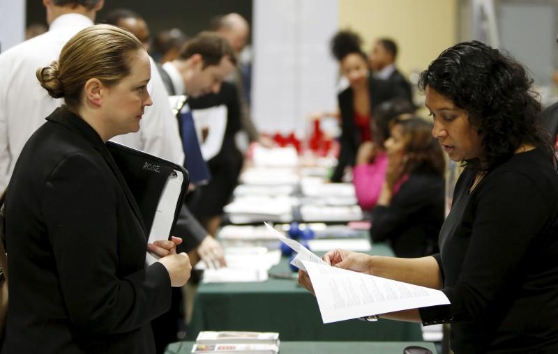 """Job applicant Rose is interviewed at a """"Hiring Our Heroes"""" military job fair in Washington"""
