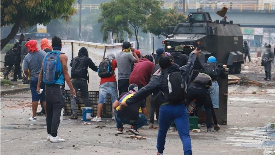 Demonstrators clash with members of the security forces during a protest against what they say was police brutality exerted in recent protests against President Ivan Duque