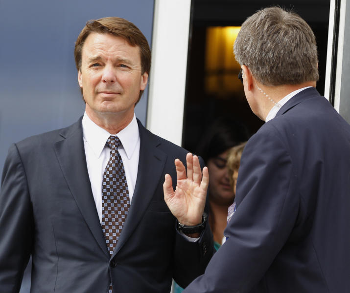 John Edwards leaves a federal courthouse after the seventh day of jury deliberations in his trial on charges of campaign corruption in Greensboro, N.C., Tuesday, May 29, 2012. Edwards has pleaded not guilty to six counts related to campaign finance violations over nearly $1 million from two wealthy donors used to help hide the Democrat's pregnant mistress as he sought the White House in 2008. (AP Photo/Chuck Burton)