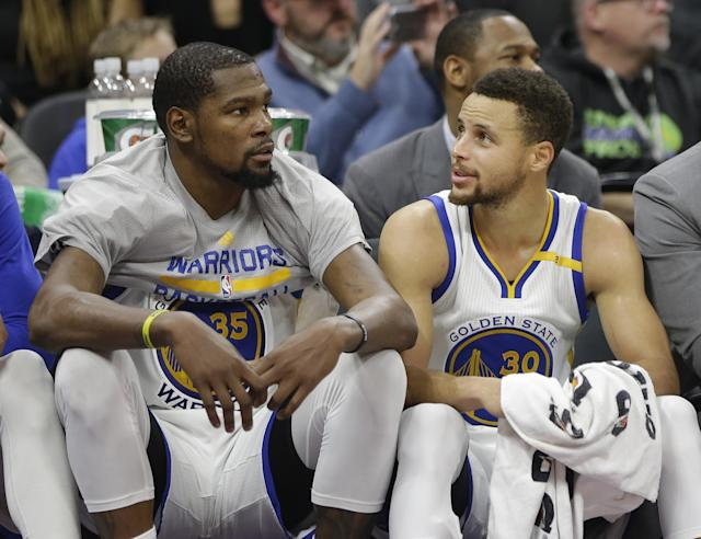 Kevin Durant and Stephen Curry will alter the Warriors' salary situation. (AP)
