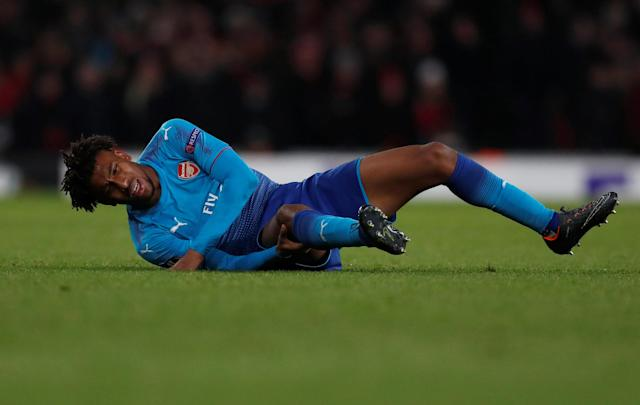 Soccer Football - Europa League Round of 32 Second Leg - Arsenal vs Ostersunds FK - Emirates Stadium, London, Britain - February 22, 2018 Arsenal's Alex Iwobi holds his leg after sustaining an injury and is later substituted off Action Images via Reuters/Peter Cziborra