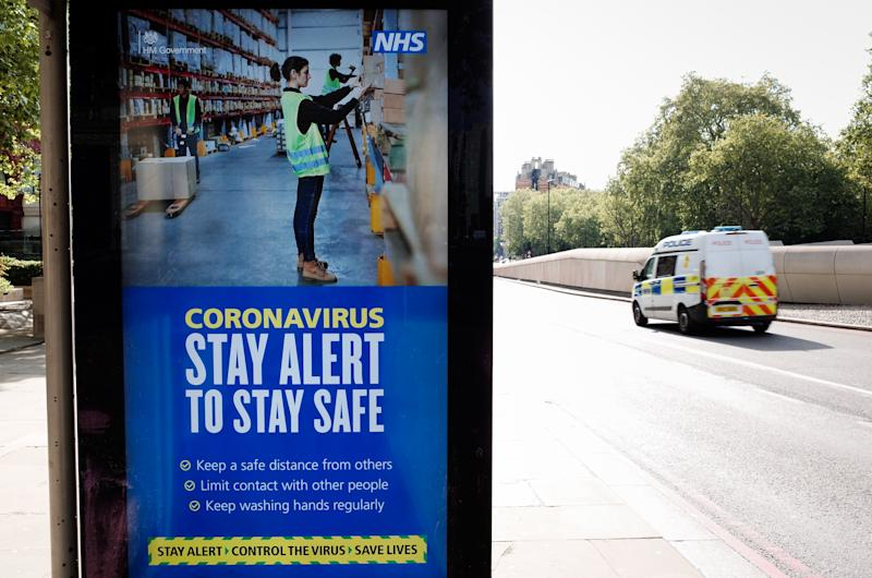 A police van drives past government messaging to 'Stay Alert', the core slogan of its new covid-19 prevention campaign, at a bus stop at Hyde Park Corner in London, England, on May 15, 2020. Nearly eight full weeks have now passed since British Prime Minister Boris Johnson ordered the country's coronavirus lockdown on March 23, although across England some of the measures, including the restriction on exercising outdoors more than once a day, have this week been removed. (Photo by David Cliff/NurPhoto via Getty Images)