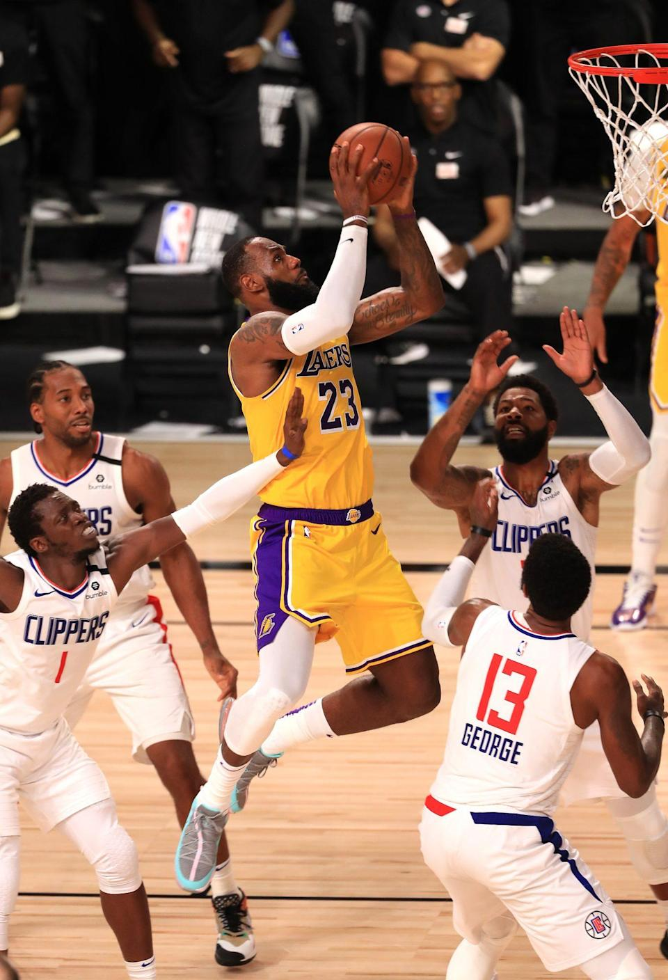 <p>LeBron James reaches to the sky on Thursday night while leading the Los Angeles Lakers to victory against the Los Angeles Clippers as the NBA resumes play in Lake Buena Vista, Florida. </p>