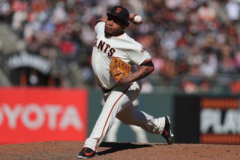 San Francisco Giants relief pitcher Reyes Moronta throws in the ninth inning against the Colorado Rockies in a baseball game in San Francisco, Sunday, Sept. 16, 2018. (AP Photo/Scot Tucker)