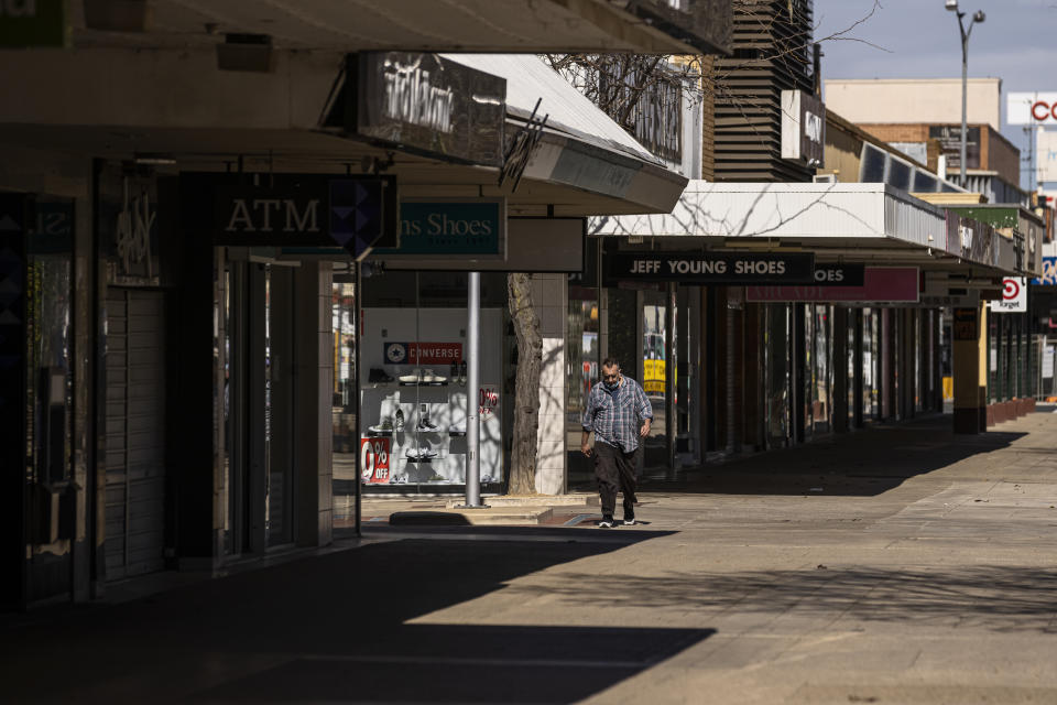 A lone person walks along the usually busy Maude Street Mall in Shepparton on Tuesday. Source: AAP