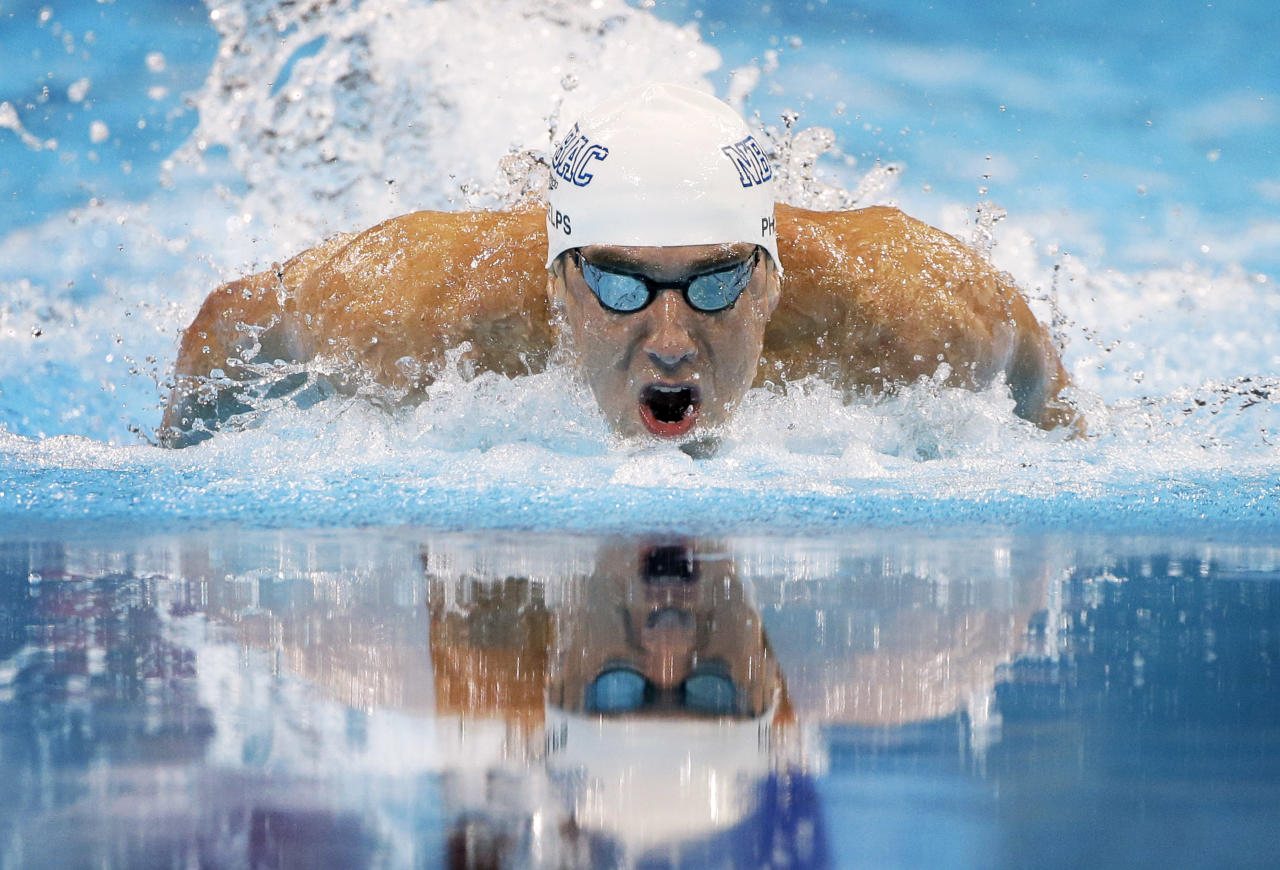 Michael Phelps swims to victory in the men's 100-meter butterfly final at the U.S. Olympic swimming trials on Sunday, July 1, 2012, in Omaha, Neb. (AP Photo/Mark Humphrey)