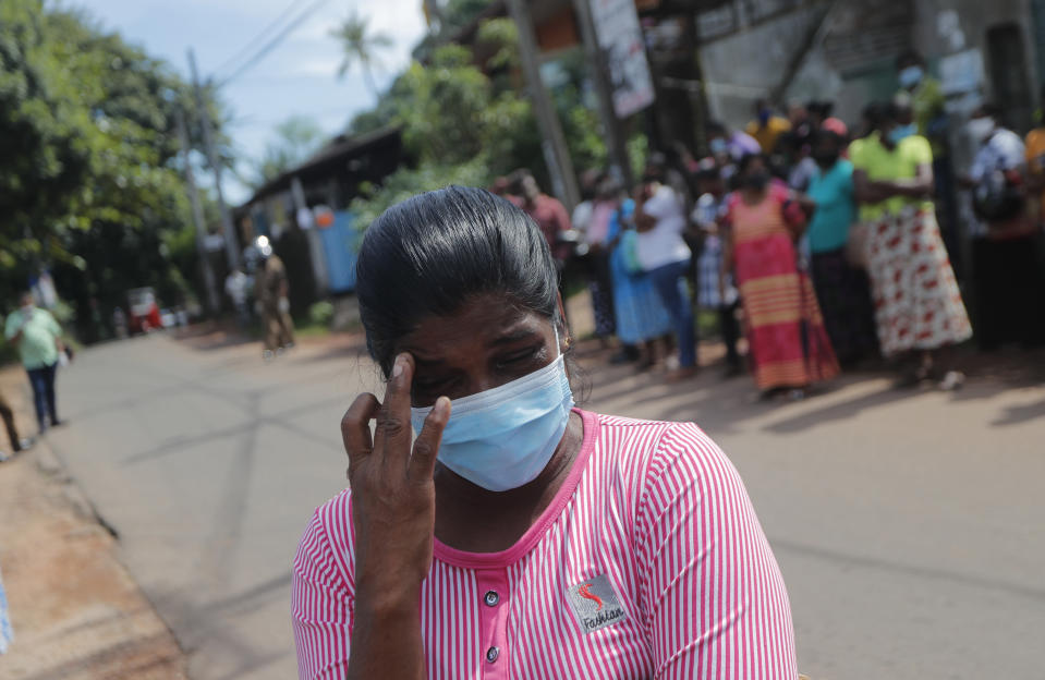 A woman weeps as family members of the inmates of Sri Lanka's Mahara prison complex gather demanding information on the condition of their relatives following an overnight unrest in Mahara, on the outskirts of Colombo, Sri Lanka, Monday, Nov. 30, 2020. Sri Lankan officials say six inmates were killed and 35 others were injured when guards opened fire to control a riot at a prison on the outskirts of the capital. Two guards were critically injured. Pandemic-related unrest has been growing in Sri Lanka's overcrowded prisons. (AP Photo/Eranga Jayawardena)