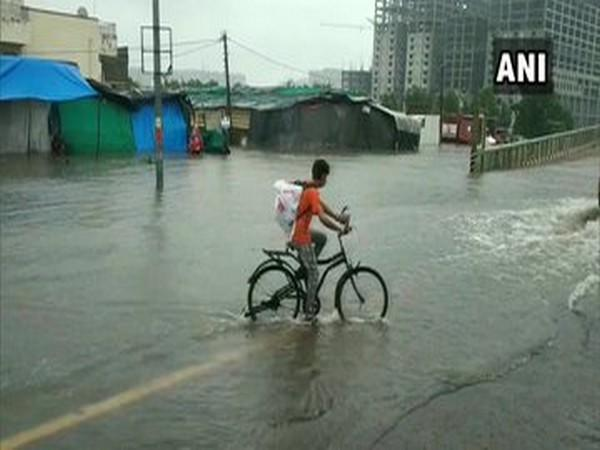 Water logging reported in several parts of Surat city after heavy rainfall in the area (Photo/ANI)