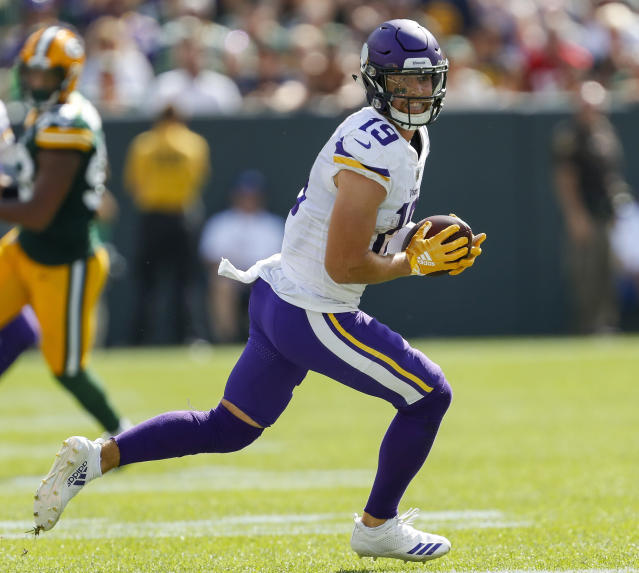 FILE - In this Sept. 16, 2018, file photo, Minnesota Vikings wide receiver Adam Thielen runs during an NFL football game against the Green Bay Packers, in Green Bay, Wis. Just like Larry Fitzgerald, Adam Thielen grew up in Minnesota trying to emulate star Vikings wide receivers Cris Carter and Randy Moss. Fitzgerald makes what could be his last visit to his hometown as an NFL player with the Arizona Cardinals on Sunday, with Thielen in a starring role with the Vikings.(AP Photo/Matt Ludtke, File)