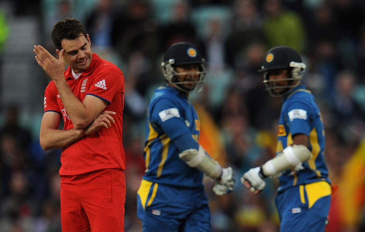 LONDON, ENGLAND - JUNE 13:  James Anderson of England looks dejected as Kumar Sangakkara and Nuwan Kulasekara of Sri Lanka congratulate each other for another boundary during the ICC Champions Trophy Group A match between England and Sri Lanka at The Oval on June 13, 2013 in London, England.  (Photo by Christopher Lee-ICC/ICC via Getty Images)