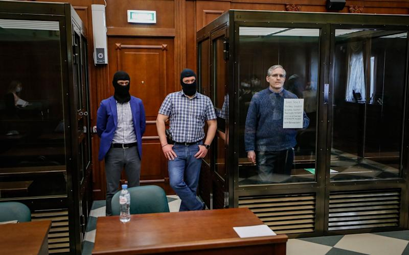 Paul Whelan, right, stands in a Moscow courtroom awaiting verdict - Yuri Kochetkov/EPA-EFE