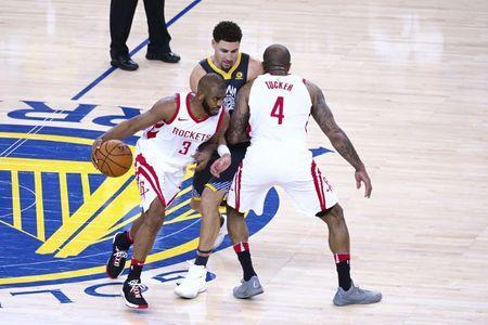 May 22, 2018; Oakland, CA, USA; Houston Rockets forward P.J. Tucker (4) sets a screen against Golden State Warriors guard Klay Thompson (11) for Houston Rockets guard Chris Paul (3) during the fourth quarter in game four of the Western conference finals of the 2018 NBA Playoffs at Oracle Arena. Mandatory Credit: Kelley L Cox-USA TODAY Sports