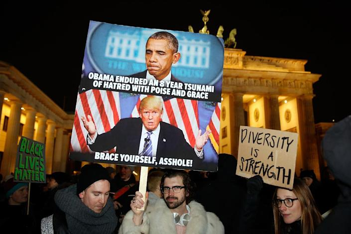 <p>Protesters gather during a demonstration against the inauguration of U.S. President Donald Trump at the Brandenburg gate in Berlin, Jan. 20, 2017. (Photo: Hannibal Hanschke/Reuters) </p>