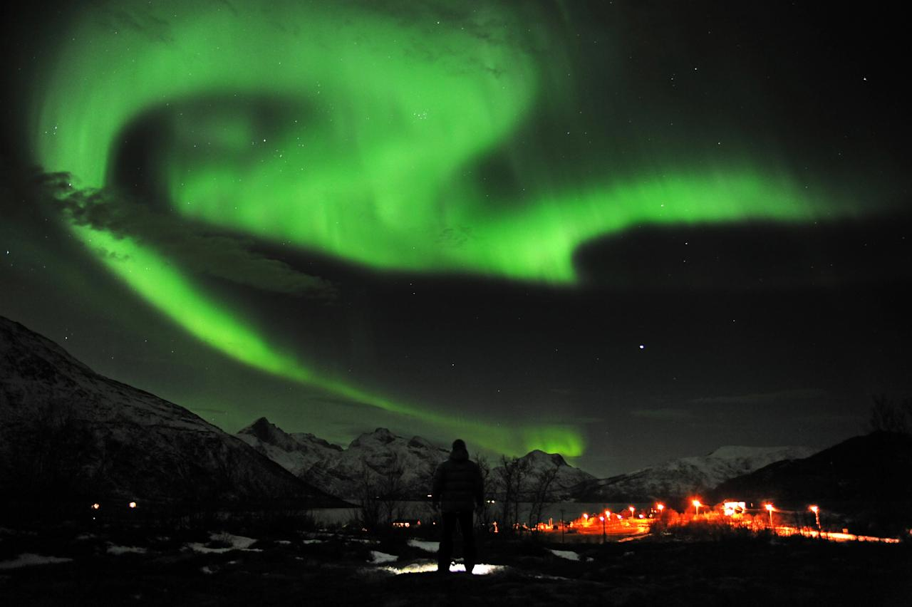 The aurora borealis, or Northern Lights, are seen near the city of Tromsoe, northern Norway, late Tuesday, Jan. 24, 2012. Stargazers were out in force in northern Europe on Tuesday, hoping to be awed by a spectacular showing of northern lights after the most powerful solar storm in six years. (AP Photo/Scanpix Norway, Rune Stoltz Bertinussen) NORWAY OUT