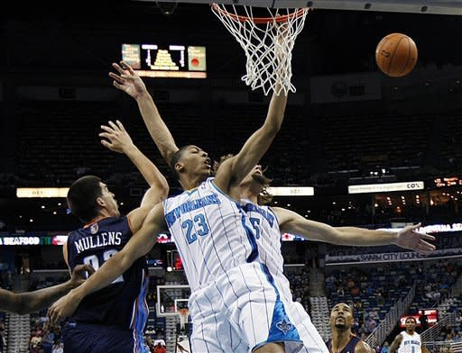 New Orleans Hornets forward Anthony Davis (23) leaps for an offensive rebound against Charlotte Bobcats center Byron Mullens (22) during the first half of an NBA preseason basketball game in New Orleans, Tuesday, Oct. 9, 2012. (AP Photo/Gerald Herbert)