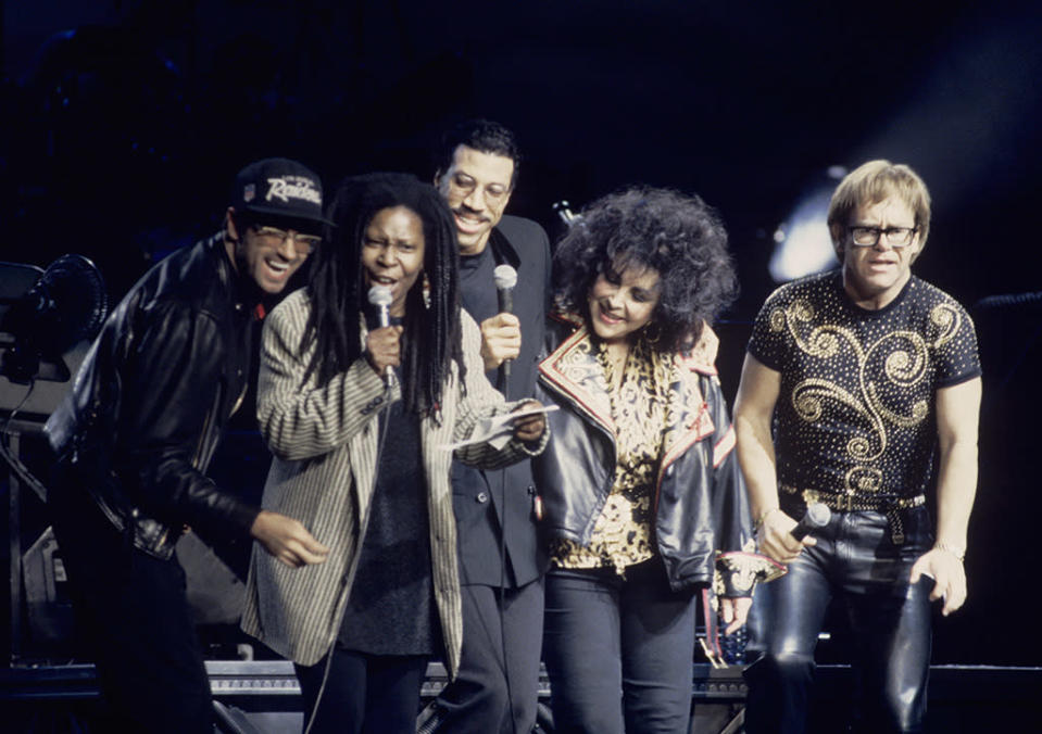 <p>George Michael, Whoopi Goldberg, Lionel Richie, Liz Taylor, and Elton John perform at a benefit concert for the Elizabeth Taylor AIDS Foundation at Madison Square Garden in New York City on Oct. 11, 1992. (Photo: Ebet Roberts/Redferns) </p>