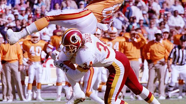 Redskins CB Brian Davis upends Buccaneers WR Mark Carrier.