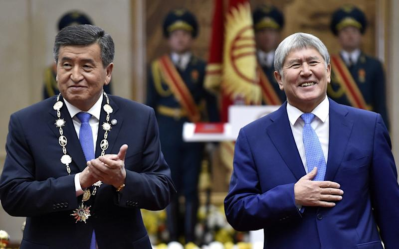 Kyrgyz President Sooronbai Jeenbekov (L) is engaged in a power struggle with former President Almazbek Atambayev - REUTERS