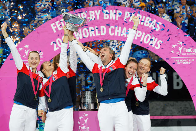 French team members celebrate on the podium after defeating Australia to win the Fed Cup tennis final in Perth, Australia, Sunday, Nov. 10, 2019. (AP Photo/Trevor Collens)