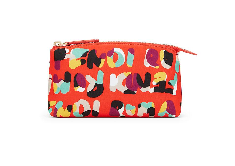 "<p>Fendi Beauty Large in Red Nylon with Multicolor Print, $250, <a rel=""nofollow"" href=""http://www.fendi.com/us/beauty-large-in-red-nylon-with-multicolor-print/p-8N011448BF049N"">fendi.com</a></p>"
