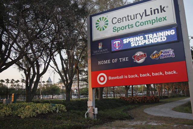 """A sign outside Hammond Stadium reads """"spring training suspended"""" after a baseball game was cancelled between the Minnesota Twins and the Baltimore Orioles, Thursday, March 12, 2020, in Fort Myers, Fla. Major League Baseball has suspended the rest of its spring training game schedule because if the coronavirus outbreak. MLB is also delaying the start of its regular season by at least two weeks. (AP Photo/Elise Amendola)"""