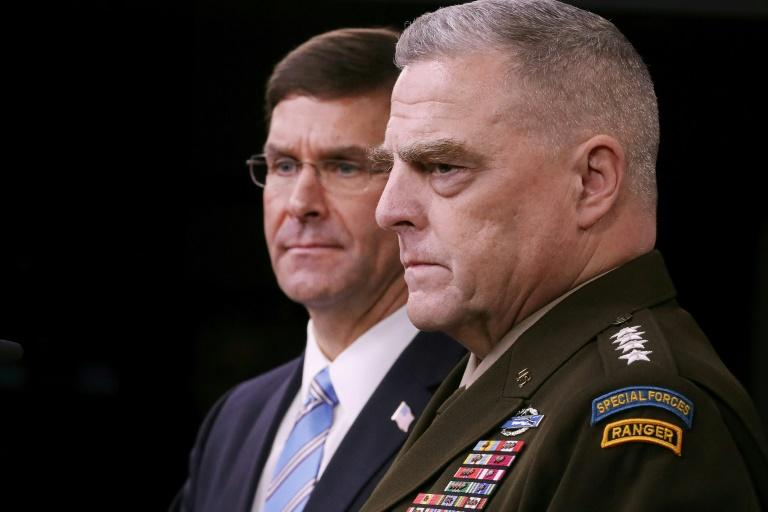 General Mark Milley (R), chairman of the US Joint Chiefs of Staff, is seen  with Defense Secretary Mark Esper at an October 28, 2019 Pentagon news briefing on the death of IS leader Abu Bakr al-Baghdadi; Milley says 500 US troops will remain in Syria