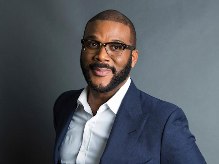 FILE - In this Nov. 16, 2017, file photo, actor-filmmaker and author Tyler Perry poses for a portrait in New York. Perry is looking to reopen his 330-acre Atlanta-based mega studio soon, but other studios in Georgia are anxiously waiting for Hollywood's green light to return back to work. Perry plans on restarting production at the Tyler Perry Studios complex in July, making it one of the first studios to domestically reopen after production was halted a few months ago to combat the spread of the coronavirus. (Photo by Amy Sussman/Invision/AP, File)