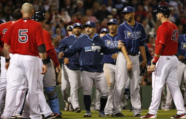 BOSTON, MA - MAY 30: Pitcher David Price #14 of the Tampa Bay Rays, second from right, is held back as the benches empty after he hit Mike Carp #37 of the Boston Red Sox with a pitch during the fourth inning of the game at Fenway Park on May 30, 2014 in Boston, Massachusetts. (Photo by Winslow Townson/Getty Images)