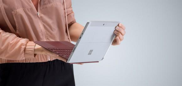 A person holding a Surface Go Tablet.