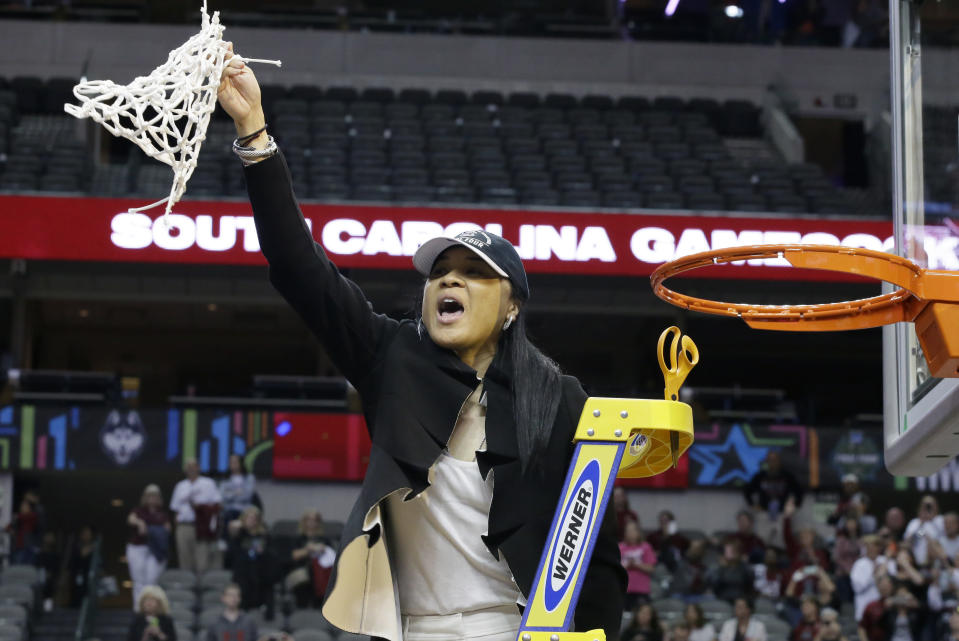 Dawn Staley cuts down the nets after South Carolina won the women's national championship in April. (AP)