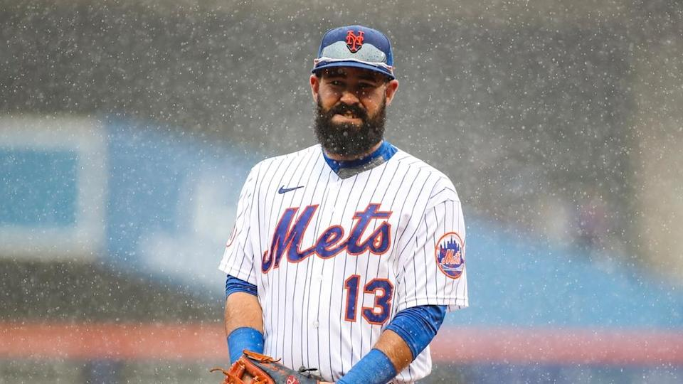 Luis Guillorme Mets stands in rain at Citi Field in April 2021