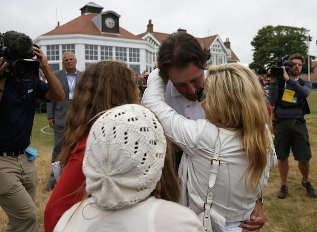 GULLANE, SCOTLAND - JULY 21: Phil Mickelson of the United States hugs wife Amy and children Evan, Amanda and Sophia after finishing the final round of the 142nd Open Championship at Muirfield on July 21, 2013 in Gullane, Scotland. (Photo by Rob Carr/Getty Images)