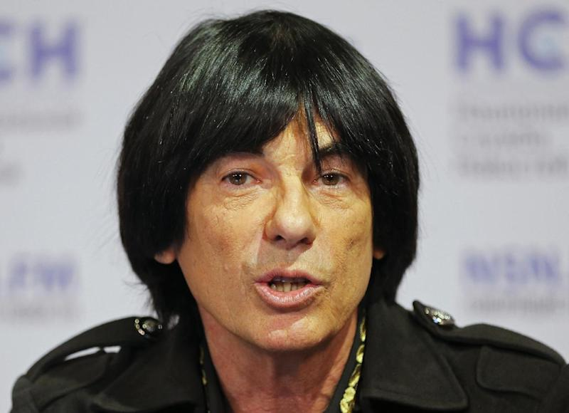 French musician Didier Marouani speaks at a news conference in Moscow, Russia, Wednesday, Nov. 30, 2016. Didier Marouani and his Russian lawyer were detained late on Tuesday and spent a night in a Moscow police station after a Russian pop star accused them of extorting 1 million euros from him in a plagiarism row. (AP Photo/Pavel Golovkin)