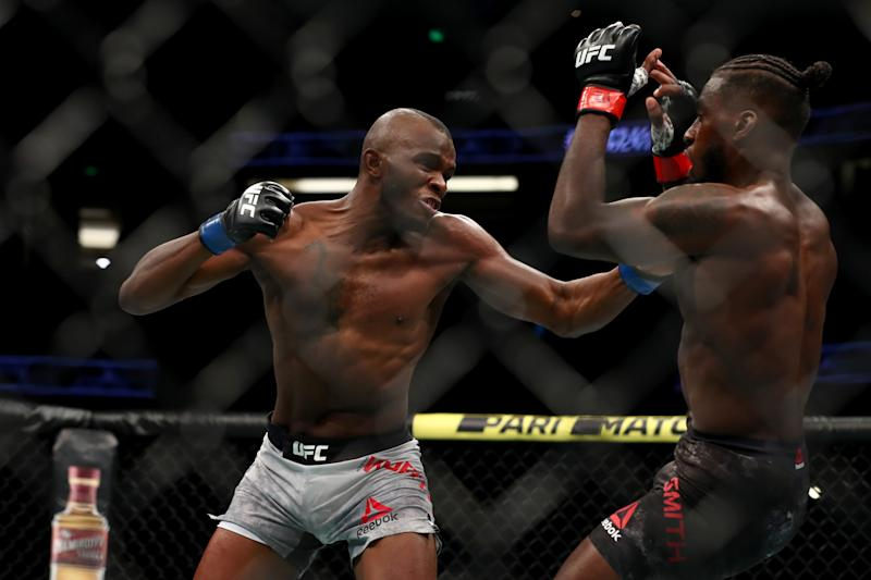 ANAHEIM, CALIFORNIA - AUGUST 17: Khama Worthy throws a punch at Devonte Smith in the first round during their Lightweight Bout at UFC 241 at Honda Center on August 17, 2019 in Anaheim, California. (Photo by Joe Scarnici/Getty Images)