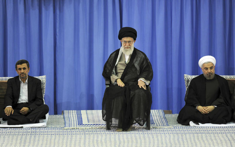 In this picture released by the official website of the Iranian supreme leader's office, Supreme Leader Ayatollah Ali Khamenei, center, President-elect Hasan Rouhani, right, and outgoing President Mahmoud Ahmadinejad, sit, in an official endorsement ceremony for Rouhani, in Tehran, Iran, Saturday, Aug. 3, 2013. Iran's supreme leader has formally endorsed Hasan Rouhani as president opening the way for the moderate cleric to take over from outgoing President Mahmoud Ahmadinejad. (AP Photo/Office of the Iranian Supreme Leader)