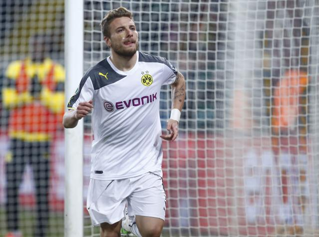 Borussia Dortmund's Italian striker Ciro Immobile celebrates his goal against Dynamo Dresden during their German Cup (DFB Pokal) soccer match against in Dresden March 3, 2015. REUTERS/Hannibal Hanschke (GERMANY - Tags: SOCCER SPORT) DFB RULES PROHIBIT USE IN MMS SERVICES VIA HANDHELD DEVICES UNTIL TWO HOURS AFTER A MATCH AND ANY USAGE ON INTERNET OR ONLINE MEDIA SIMULATING VIDEO FOOTAGE DURING THE MATCH.