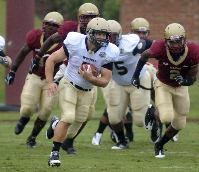 FILE - In this Sept. 29, 2012, file photo, Wofford College's Eric Breitenstein rushes away from Elon defensemen to score a touchdown during an NCAA college football game in Elon, N.C. Payton Award finalists Taylor Heinicke, the record-setting quarterback from Old Dominion, and Breitenstein, the 2,000-yard rusher from Wofford, have been selected to The Associated Press FCS All-America football team on Wednesday, Dec. 12, 2012. (AP Photo/Burlington Times-News, Scott Muthersbaugh, File)